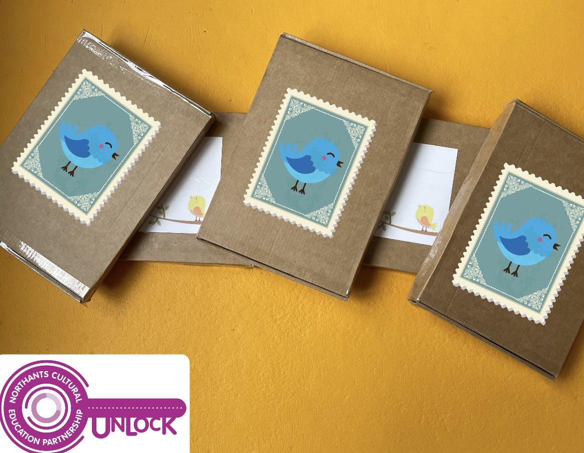 A picture of boxes containing the Songwriting Journal on a yellow background ready to be posted